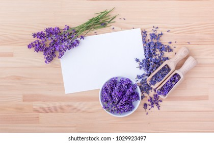 top view of lavender flowers with a white copy space on a wooden ground