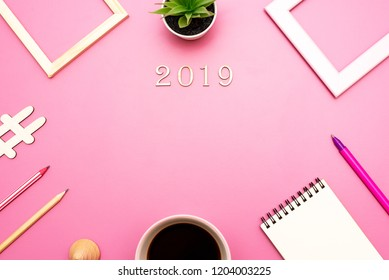 Top view of the layout for the application of records, greetings for the new year 2019 in the office style on the purple table