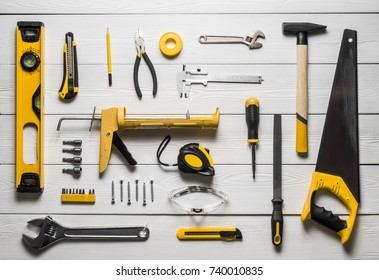 Top view layout of tools on white wooden