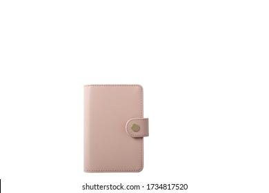 Top-Ansicht eines Leder kleinen hellrosa Pink Personal Planer mit einem goldenen Stift isoliert auf weißem Hintergrund.