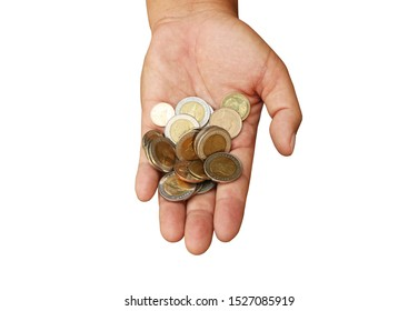 Top view ,Left hand hold the pile of Thai Baht coins isolated on white background with clipping path.