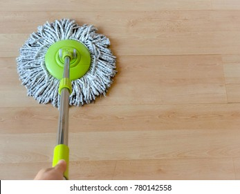 Top view left hand woman hold modern mop to cleaning floor. Copy space. Concept service.