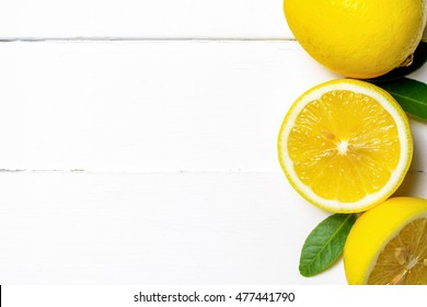 Top view of lemons on wood table with copy space
