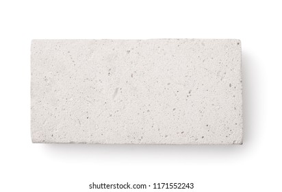Top view of lightweight foamed gypsum brick isolated on white