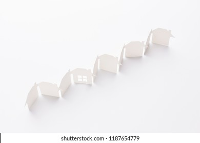 top view of line linked of paper cutout houses with detail one on white background