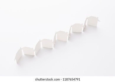 top view of line linked of paper cutout houses on white background