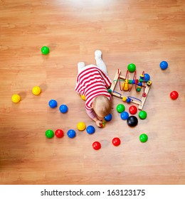 Top view of little girl playing on the floor
