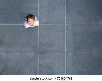Top view of little girl smiling