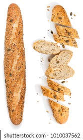 Top view of loaf and slices of whole grain multigrain bread  include edible seeds such as poppy, millet,  flaxseed,  pumpkin seeds, and sunflower seeds isolated on white background.