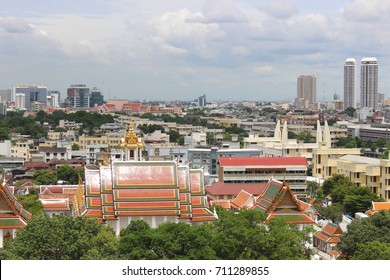 Top view Loha Prasat and Bangkok city , Wat Ratchanaddaram ,Bangkok ,Thailand.The third Loha Prasat ,the one and only structure of its left in the world.
