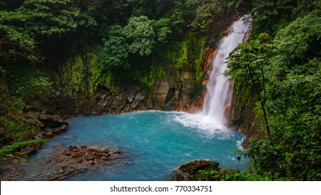 Top view long exposure of celestial blue waterfall and pond in volcan tenorio national park, Costa Rica