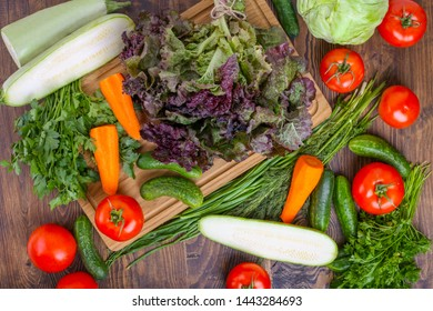 Top view of lots of vegetables on wooden table