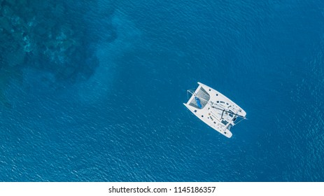 Top view of a luxury white catamaran boat.