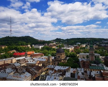 Top view. Lviv bird's-eye view. Lviv old town from above. Panorama of old city of Lviv. Wonderful scenic image trees foliage old gothic style buildings