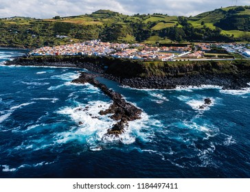 Top view of Maia city and ocean surf on coast reefs of San Miguel island, Azores, Portugal.