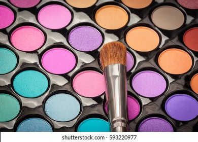 Top view of make-up eyeshadow palette with brush. Above view