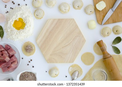 Top view making of traditional Slavs food pelmeni dumplings background frame. Ingredients, kitchen items for cooking ravioli. Text space, flat lay.