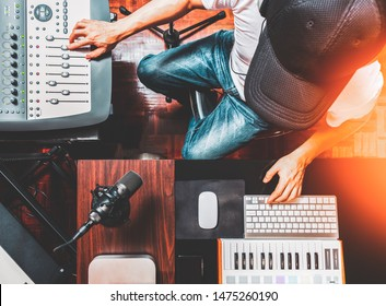 top view of male DJ, producer, composer enjoy mixing music in home recording studio. music production, broadcasting concept