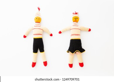 Top view of a male and a female handmade doll on white background representing togetherness