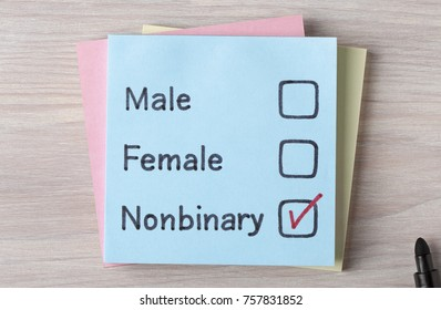 Top view of Male,Female and Non binary handwritten on a note.