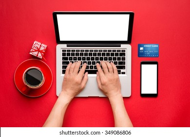 Top view of a Man buying christmas gifts online - online shopping concept. View from above with copy space