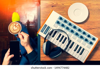top view of man enjoy drinking coffee, listening music and browsing internet on smartphone in the morning