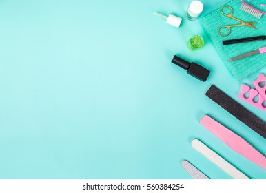 Top view of manicure and pedicure equipment on blue background