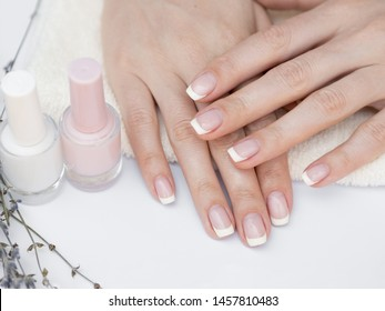 Top view manicured hands and nail polish