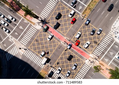 Top View of Many Cars Crossing