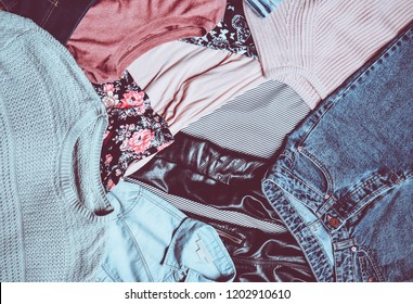 Top view of many different women's clothing layout. Second hand. Trend clothes and accessories. Casual Style.