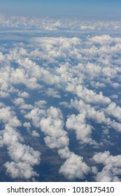 Top view many little clouds in blue sky from airplane