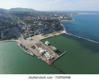 Top view of the marina and quay of Novorossiysk. Urban landscape of the port city.