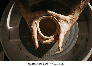 Top view of the master ceramist working at his studio