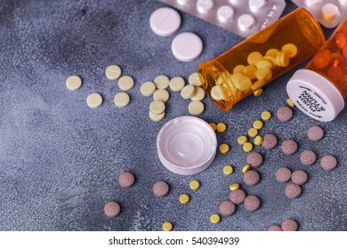 Top view of medicine Pills and tablets with orange pill bottles for healthcare. medical help concept. copyspace for text