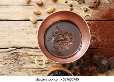 top view melted chocolate in metal pan rustic background