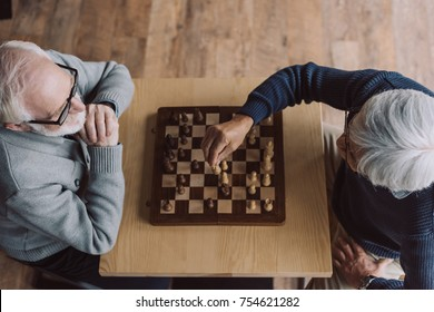 top view of meltiethnic senior men playing chess
