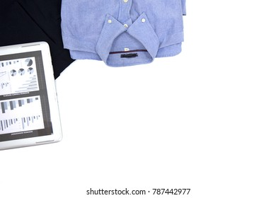 Top view men shirt, long trousers, business chart tablet with copy space.