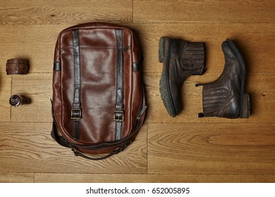 top view. Mens clothes and accessories on wooden background