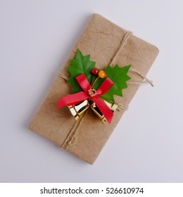 Top view of Merry christmas and Happy new year with gift box on gray background, decorated and square size.
