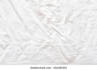 Top view of a messy bedding sheet after a long night sleep.