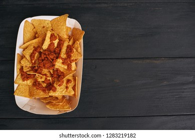 Top view of mexican food dish nachos con carne. The concept of Mexican cuisine.