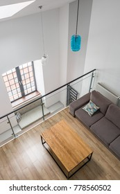 Top view of a mezzanine living room with table and couch