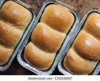 Top view milk bread rolls in aluminium foil box.