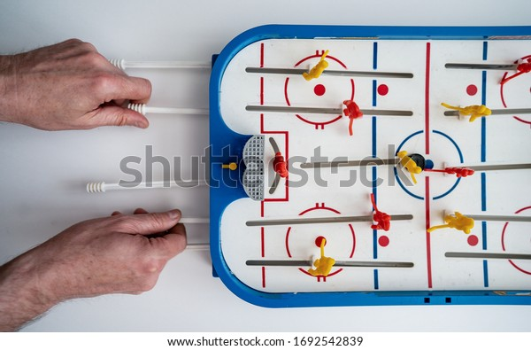 Top view of mini table ice hockey. The concept of entertainment and attracting people to sports and active lifestyles. Home entertainmentin quarantine for Coronavirus