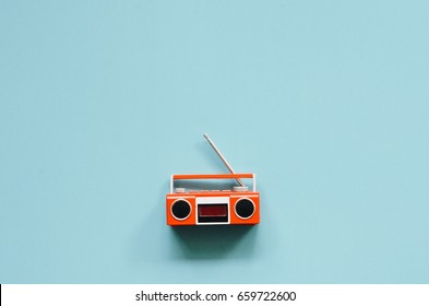 Top view of miniature vintage radio and tape recorder on blue color background,copy space