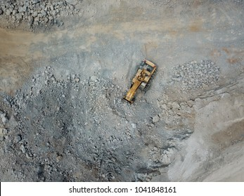 Top view of mining machines in limestone mine.