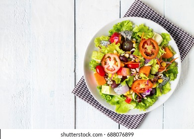 top view mix fruit and vegetable salad on white dish