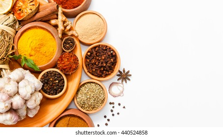 Top view mix indian spices and herbs different size terracotta pots on white background with copy space for design vegetables, healthy lifestyle, spices, herbs or foods content.