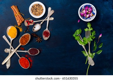 Top view mix Indian spices and herbs on dark wooden background with copy space for  healthy lifestyle, spices, herbs or foods content.