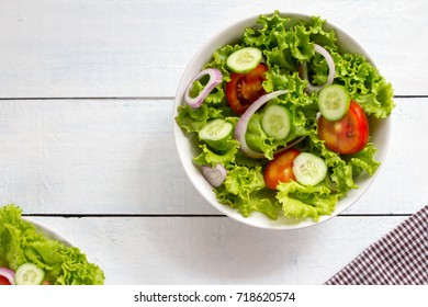 top view mix vegetable salad on white bowl